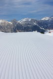 Skiing slope. Newly made skiing slope and high mountains Stock Images