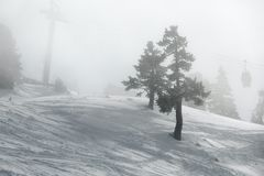 Skiing slopes in fog Royalty Free Stock Image
