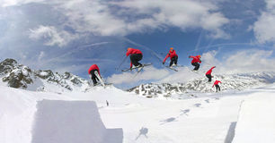 Skiing in the snow park. Acrobatic skiing in the snow park Stock Photos
