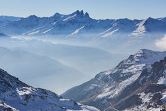 Skiing and snowboarding in alps Stock Photo