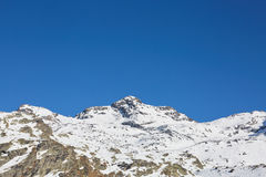 Skiing and snowboarding in alps Stock Photography