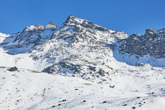 Skiing and snowboarding in alps Stock Photos