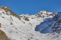 Skiing and snowboarding in alps Royalty Free Stock Photography