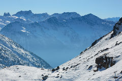 Skiing and snowboarding in alps Royalty Free Stock Images