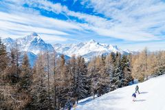 Skiing and snowboarding in high mountains, with Trentino Alto Ad. Ige`s peaks in the background, San Candido. Italy royalty free stock photography