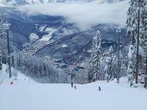 Skiing and snowboarding at the resort Roza Khutor, Krasnaya Polyana, Russia royalty free stock photo