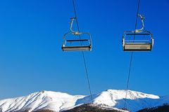 Skiing and snowboarding in ski piste and ski lift in the alps switzerland.  Royalty Free Stock Image