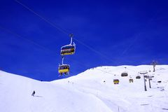 Skiing and snowboarding in ski piste and ski lift in the alps switzerland.  Stock Photo