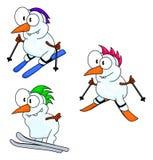 Skiing snowmen Royalty Free Stock Image