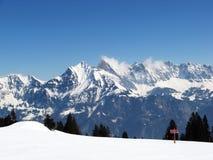 Skiing in swiss alps Stock Photos