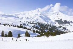 Skiing in swiss alps. People skiing in swiss alps mountain Stock Photos