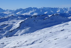 Skiing Switzerland 2. Vast Ski Area and view into the Swiss Alps in Winter stock images