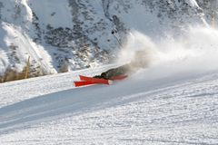 Skiing Teen Falling. In the powder snow after a high jump Stock Photography