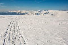 Skiing tracks in mountains Stock Photos
