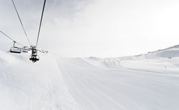 Skiing tracks and ski lift in Paradiski area, France Royalty Free Stock Photography