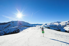 Skiing tracks on snow slopes in sunny day Royalty Free Stock Photography