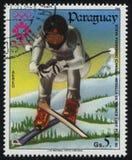 Skiing at Winter Olympics at Sarajevo. RUSSIA KALININGRAD, 19 APRIL 2017: stamp printed by Paraguay, shows Steve Podborski,  downhill skiing at Winter Olympics Royalty Free Stock Photography