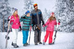 Skiing, winter, snow and fun - family enjoying winter vacations Stock Photography