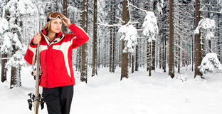 Skiing woman in a forest Royalty Free Stock Photography