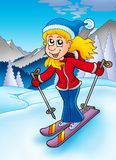 Skiing woman in mountains Stock Image