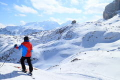 Skiing young boy. Is looking to the snowy mountains royalty free stock image