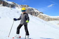Skiing young girl. On a racing track Stock Photos