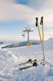 Skiis and Ski Resort. Skiis in the snow and ski lift in background on mountain Pirin, Bansko Resort, Bulgaria Royalty Free Stock Photo