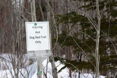 Skijoring and Dog Sled Trail Only. Sign indicating type of use for a particular trail in Minnesota Royalty Free Stock Image