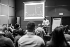 Skiled Public Speaker Giving a Talk at Business Meeting. royalty free stock photos