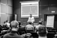 Skiled Public Speaker Giving a Talk at Business Meeting. royalty free stock images