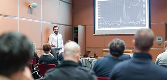 Skiled Public Speaker Giving a Talk at Business Meeting. stock photography