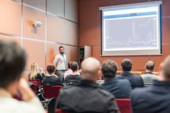 Skiled Public Speaker Giving a Talk at Business Meeting. stock photos