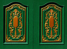 Skilfully crafted green shutters Royalty Free Stock Photos