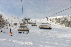 Skilift at alpine ski resort Royalty Free Stock Photos