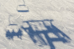Skilift shadow on skisloope Royalty Free Stock Images