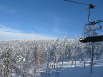 Skilift in the sunshine. Landscape with snow, trees and ski lift Royalty Free Stock Photo