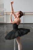 Skill ballerina posing in ballet class Stock Photos