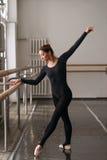 Skill ballerina posing in ballet class Stock Photography