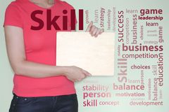 Skill concept. a girl in red holds a wooden sign.  Royalty Free Stock Images