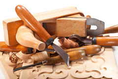 Skill. Cutters for wood, planer, ornament, shavings on white background Royalty Free Stock Photo
