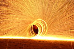 Skill Man playing fireworks by spinning wood pole with fuel oil Royalty Free Stock Photos