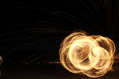Skill Man playing fireworks by spinning wood pole with fuel oil Stock Image