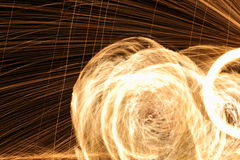 Skill Man playing fireworks by spinning wood pole with fuel oil Royalty Free Stock Images