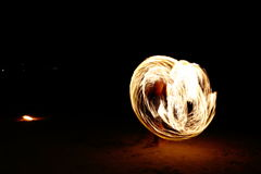 Skill Man playing fireworks by spinning wood pole with fuel oil. High Skill Man playing fireworks by spinning wood pole with fuel oil and fire, circle around as Stock Images