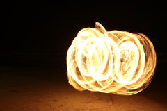 Skill Man playing fireworks by spinning wood pole with fuel oil. High Skill Man playing fireworks by spinning wood pole with fuel oil and fire, circle around as Stock Photos