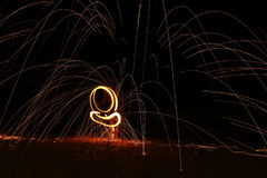 Skill Man playing fireworks by spinning wood pole with fuel oil. High Skill Man playing fireworks by spinning wood pole with fuel oil and fire, circle around as Royalty Free Stock Photo