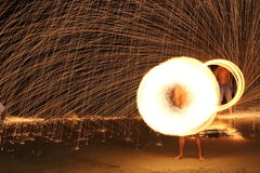 Skill Man playing fireworks by spinning wood pole with fuel oil Royalty Free Stock Photography