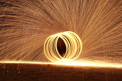Skill Man playing fireworks by spinning wood pole with fuel oil. High Skill Man playing fireworks by spinning wood pole with fuel oil and fire, circle around as Stock Image