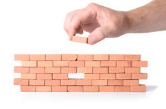 Skill team building. Concept for skill or building a team working together, hole in the wall Royalty Free Stock Photo