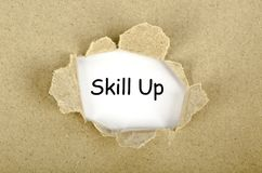 Skill up words on a torn paper. Concept royalty free illustration